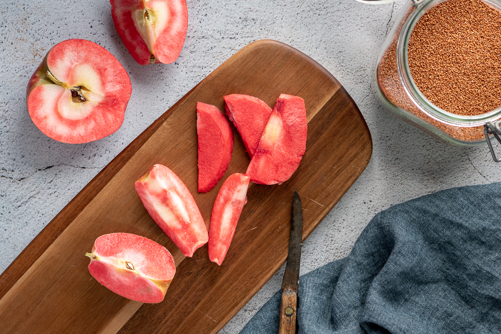 Lucy™ apples on a cutting board