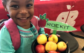 Girl holding Rockit™ apples
